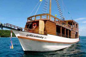 Wooden sailing junk at sea off Phuket